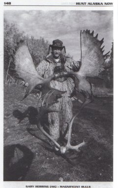 Hunt Alaska Now, Hunter with Moose and Caribou